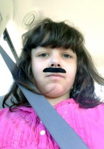 Syd and the mustache she got out of a vending machine at Pizza Hut. She wore it all the way home to Loveland.