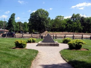 The Cotton Gin Assault Park. The pyramid of cannonballs marks where Patrick Cleburn fell. In the background is the newly cleared land for the next round of battlefield restoration.