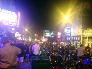 A very crowded, very colorful Beale Street.