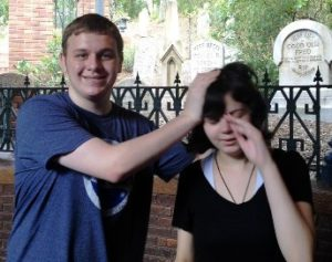 Outside the Haunted Mansion. S.Hooligan isn't crying; she probably was in the process of hiding her face from the camera.