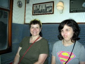 In our compartment on the train. (Is that look on S.Hooligan's face for me or the train? Who knows?)